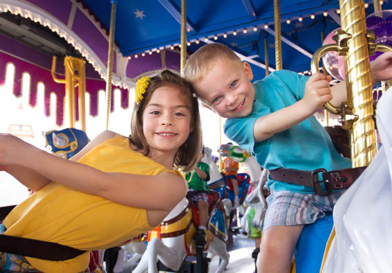 children on carousel