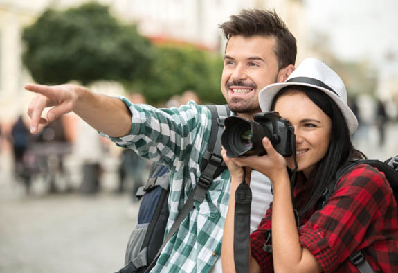 woman taking photo with man