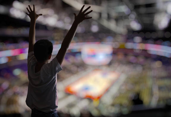 kid cheering in sports arena